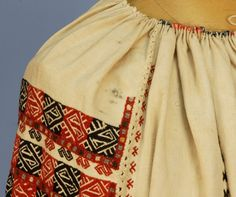 Cream cotton embroidered in a geometric pattern of earth tones, gathered at the neck and sleeve. on Apr 2013 Embroidered Blouse, Fashion Branding, Shirt Blouses, Boho Shorts, Auction, Embroidery, Sleeves, Pattern, Cotton