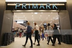 Shoppers enter a Primark clothing store a day after the store's opening on July 12, 2012 in Berlin, Germany. Primark is expanding aggressively in Germany and is becoming a serious competitor to other low-cost clothing store chains.