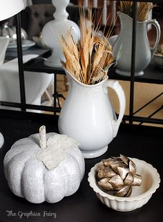 Fall/Thanksgiving neutral decor- dried wheat in a pitcher, a book page pumpkin and- my favorite- a silver artichoke.