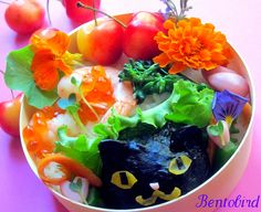 Summer bento: Shrimp and salmon roe, broccolini, plum-garlic pickles, radish sprouts and edible flowers.