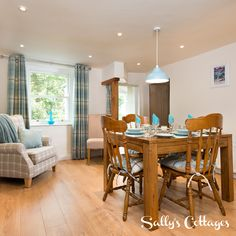 The Laura Ashley-esque dining room with feature fireplace is a light, airy and fresh space at our new cottage for 5 guests in Ullswater, Bluebell Cottage.