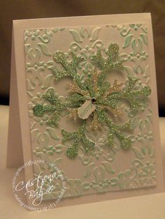 Snowflake with glitter and embossed background - looks a bit vintage, and the colors could be changed from green to blue or aqua for a different feeling