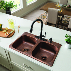 Replace your old boring kitchen sink with a SINKOLOGY™ Drop-In Copper Kitchen Sink. Made with high-quality copper, this double-basin sink produces a rich yet luxurious patina as it ages. With its elegant design and flush fit, this eye-catching sink will elevate the look of your kitchen.