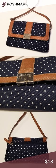 """Chaps navy blue and white polka dot crossbody bag Chaps navy blue and white polka dot bag with faux leather detail in excellent condition. *48"""" strap *9""""L x 6""""H x 1""""W *1 inner zipper pocket, 1 back zipper pocket *magnetic front closure *silver hardware *pristine interior Chaps Bags Crossbody Bags"""