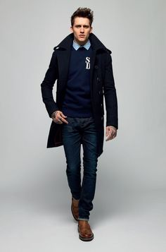 Shop this look on Lookastic:  http://lookastic.com/men/looks/brogues-and-jeans-and-crew-neck-sweater-and-dress-shirt-and-pea-coat/448  — Brown Leather Brogues  — Navy Jeans  — Navy Crew-neck Sweater  — Blue Dress Shirt  — Navy Pea Coat