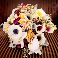 We love the bride's gold heels and her bouquet filled with white anemones.