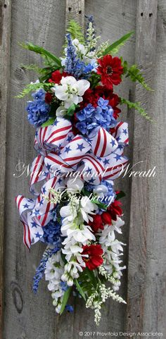 Elegant Patriotic Floral Swag. Hydrangeas, Dahlias, Wisteria and Cosmos in vibrant red, winter white and federal blue gather with meadow grass, wildflowers and ferns to create this elegant and stunnin