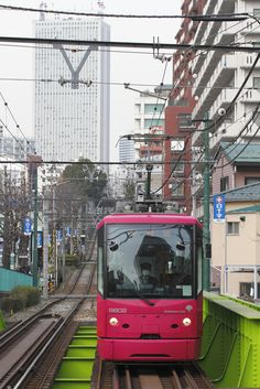 Tokyo, Japan, love the neon colours... at least you can see the train! XD