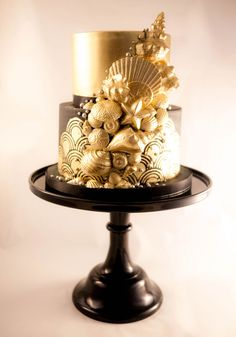 Coastal Cake Company in British Columbia made a gold and chocolate wedding cake for a Great Gatsby-meets-beach wedding theme. Canada's Prettiest Wedding Cakes For 2016 | Weddingbells