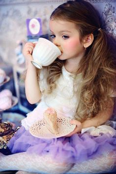 Kids Fashion. My little girl loves sun dresses in the summer. However she loves her sorts too. This adorable she loves to play tea time with her friends and toys and even us. She's a sweetie. The blonde in the pic.