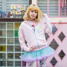 Harajuku's Listen Flavor is well known for its mix of cute and dark imagery, but this stylish hoodie takes the strange juxtaposition to whole new levels.   Available in black, baby pink or mint, each zip-up hoodie has a cute motif of the brand's popular Twinkle-chan bear character on the front and a large print on the back with Twinkle-chan sitting in an ice cream sundae surrounded by syringes a...