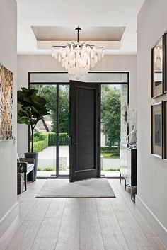 Stylish Entryway Ideas for a Beautiful First Impression - jane at home Farrow & ., Stylish Entryway Ideas for a Beautiful First Impression - jane at home Farrow & Ball Ammonite gray on the walls and Pigeon on the front door, combined. Mediterranean Decor, Mediterranean House Plans, Farrow Ball, Entry Foyer, Grand Entryway, Interior And Exterior, Interior Glass Doors, Black Interior Doors, Hall Interior