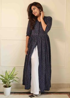 Look sensational in our breezy dark blue floral kurta. Flared kurta infused with stylish front slit highlights the blissful look! Pockets on the both sides are inserted to give you an amazing comfortable experience. Modest Fashion, Fashion Dresses, Short Frocks, Punjabi Suits, Cotton Lace, Indian Wear, Kurti, New Look, Long Dresses