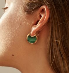 The perfect hoop. Lightweight yet bold and colorful, these hoops are an instant classic. Available in Brass withMalachite.