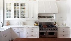 White Shaker cabinets; Carerra countertops; Covered range