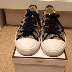 Coach Bobbi Sneakers Black & White signature sneakers with black leather on the back of the shoe. Black shoe laces. Has a little wear on the back of the right shoe rubber. Otherwise in great condition. Coach Shoes Sneakers