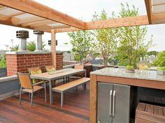 terrasse extérieur avec cuisine et pergola en bois