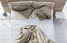 Why it is healthier to not make your bed in the morning. Yes, you read that right. Also, a sweet video of how to make your bed while you are still in it. Make Your Bed, How To Make Bed, Messy Bed, White Sheets, Clean Sheets, Wood Headboard, One Night Stands, Dust Mites, Cozy Bed