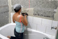Learn how to tile a bathroom wall with the detailed step-by-step ...