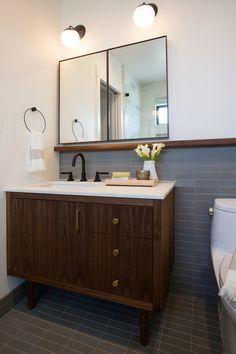 midcentury style vanity, matching tile floor & wainscot