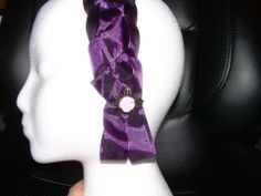 Purple satin hair braid with ivory flower finding.