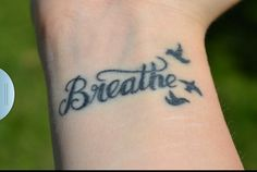 Breathe tattoo. but with white ink, and only one dove..