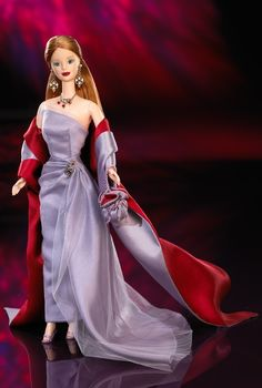 "Vera Wang is probably one of my favorite fashion designers. This doll, sold in 1999, was a limited edition and is no longer available...I didn't have the $135 it cost then, but I still love this elegant ""red-carpet"" style even now. I gotta admit, I'm a bit jealous of Barbie's amazing clothes!"