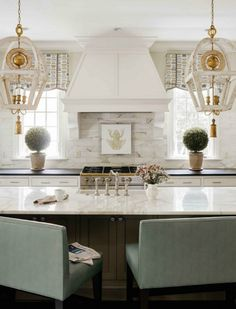 10 Kitchen Islands | A space that marries form and function—and often serves as a focal point—as the above design by Charlotte-based Mary Tobias Miller Interior Design shows, with the right mix of elements (statement lighting, anyone?) this multi-use area can be stylish oasis in the busiest room of the house.