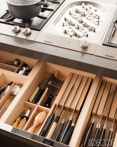 In this Manhattan kitchen, an Alessi trivet sits on the plancha next to a gas range, and the fitted drawers by Dada. Tour the entire kitchen