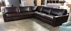 "This Customer Order was for our Braxton Grand Corner Sectional in the 46"" overall depth with Cushion Option 2, which features less cushions, but in a wider format. The overall length dimensions come in at 133""L x 133""L, but dimensions can be customized to suit your space. Italian Brompton Cocoa is a Full Grain, Full Aniline, Waxed Pull-up Leather. This leather will display natural characteristics, markings and color variation of the European hides used to produce it."