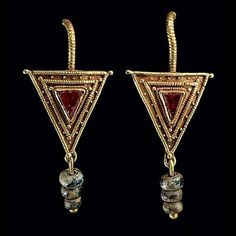 Ancient Roman gold, garnet and glass earrings. 2nd-3rd century AD