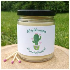 "This one says ""life is like a cactus, thorny but beautiful. Beeswax Candles, Scented Candles, Gifts For Dad, Gifts For Friends, Natural Air Purifier, Bridesmaid Proposal Gifts, Candle Labels, Maid Of Honour Gifts, Therapeutic Grade Essential Oils"