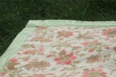 Trim a picnic blanket out of an old bridesmaid's dress. This is cute. Would work for baby blankets too.