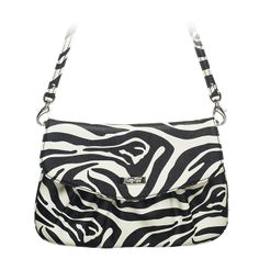 """Jane-Zebra Grace Adele Clutch    Cute and curvy, Jane features a glossy cross-stitched pattern or sleek animal print that adds just enough intrigue to your perfect look.     Fits inside the exterior pocket on your favorite Grace Adele bag.     • Faux leather  • 10"""" L, 6"""" H  • 26.75"""" detachable strap    zebra fashion print    https://myfashions.graceadele.us/GraceAdele/Buy/ProductDetails/10610"""