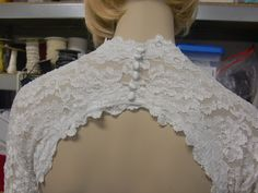 Key hole, 3/4 length lace sleeves. I want this mom, can we make it or find it cheaper