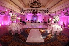 Love this pink uplighting and the gobo monogram projectors on the dance floor at this wedding reception.