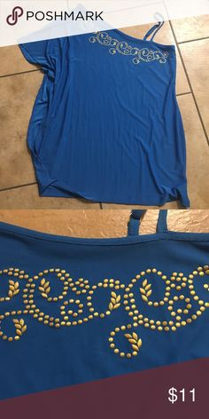 Avon sz med one shoulder w/neck detail top. Nwot Avon sz med one shoulder/ cool shoulder with neck detail top. Nwot. Wing arm is flowy but  sown in. Stretchy. Blue with bronze colored detail around neck. Please bundle under $15 items. Thank you Avon Tops