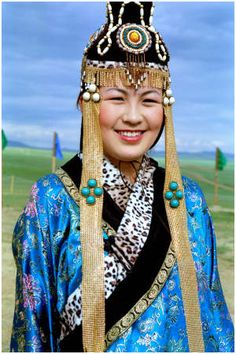 Mongolia |  Portrait of a woman attending the Fashion show at the Festival of Eurasia | ©Hans Hendriksen