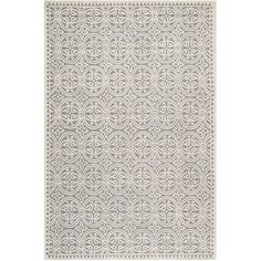 Anchor your living room seating group or define space in the den with this artfully hand-tufted wool rug, featuring a linked medallion motif for eye-catching...