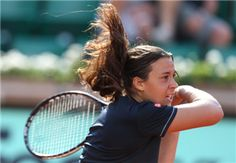 France's Marion Bartoli hits a return to Czech Karolina Pliskova during their women's Singles 1st Round tennis match of the French Open tennis tournament at the Roland Garros stadium, on May 28, 2012 in Paris.