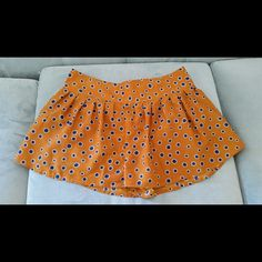 Summer time burnt orange shorts Cute summertime shorts.  Burnt orange with blue dots. Back has the nicest look with zip up. Love Tree Other