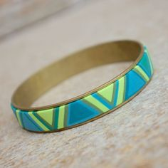 Design by Petra Nemravova Channel bracelets combine polymer clay and metal. Metal embellished with colour is simply beautiful! Sculpey Souffle adds a new dimension to the metal – both the contrast and the harmony.