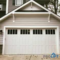 Designed with tall panels and a carriage house look, this insulated steel garage door by Amarr is both stylish and energy efficient. Teacher Door Hangers, Teacher Doors, Garage Door Panels, Garage Door Design, Orange Front Doors, Front Door Colors, Old Garage, Steel Garage, Front Door Lighting