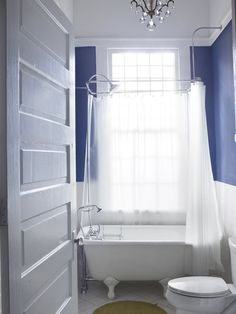 I love white bathrooms with a pop of color and this hue of blue is divine.