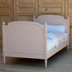 Swedish Andres Kids Bed available @ CoachBarn.com  lends royalty-inspired elegance to a kids bedroom in vintage pink. #kidsbeds #twinbeds #pinkbed #coachbarn