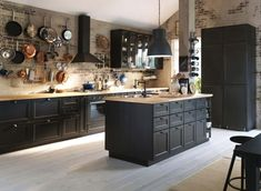 15 Beautiful Black Kitchens /// The Hot New Kitchen Color I'm really feeling this open space…the light brick with the black creates such a contrast …then blended with the open pot rack and glass door cabinets…it is so totally inviting. Black accents are e Black Kitchen Cabinets, Kitchen Cabinet Design, Black Kitchens, Interior Design Kitchen, Cool Kitchens, Kitchen Black, Ikea Kitchens, Wood Cabinets, Wood Countertops
