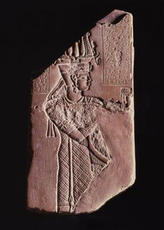 Votive Plaque of King Tanyidamani. The fragment, discovered in the lion temple at Meroë, capital of the Meroitic Kingdom, was part of a commemorative monument to King Tanyidamani. One side depicts the ruler in royal costume with ram's-head earrings, an Egyptian crown, and a scepter in his hand. An image of the lion-headed war- and fertility-god Apedemak