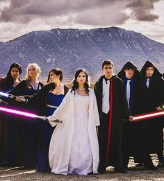 The wedding party all dressed up in Star Wars gear.