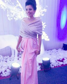 "Vishva Savani looking absolutely glamorous in this shell pink gown with a should wrap from our diffusion line AMOHA  ""I looked beautiful and got a lot of complements because of my beautiful dress"" quotes the stunning client."