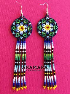 Dimensions Length 18.5 inches (46.99 cms) from point to point The diameter of the medallion is 2.4 inches (6.09 cms) Earrings length is 5 inches (12.70 cms) The Huichol represent one of the few remaining indigenous cultures left in Mexico. They live in self-imposed isolation, having chosen